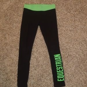 Green and black justice equestrian leggings.